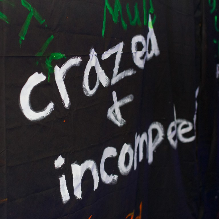 The words crazed and incompetent appear in on the black walls at the beginning of the Tunnel.