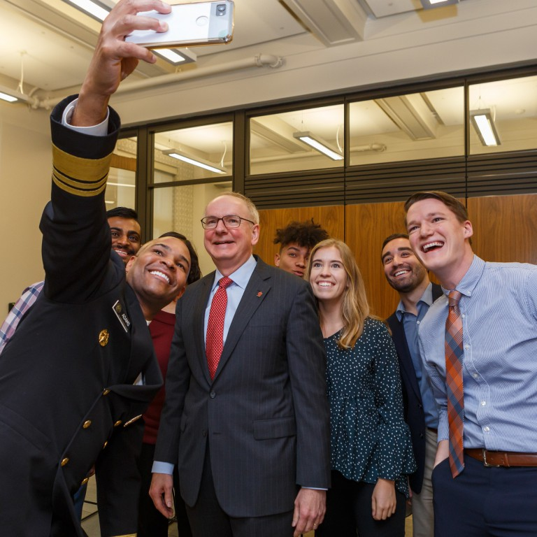 IU medical students talk a selfie with Jerome Adams and Jay Hess