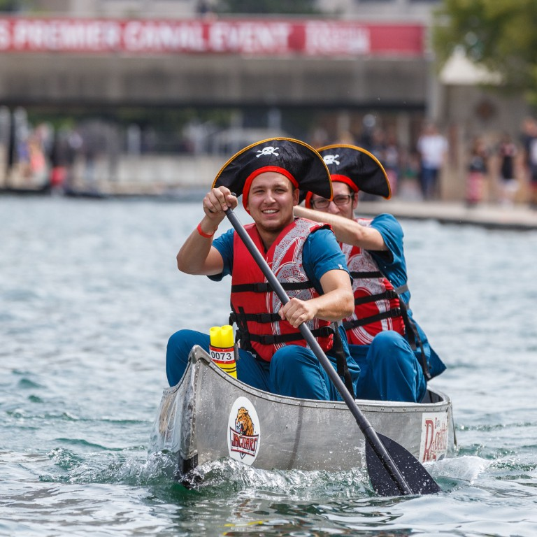 Students dressed up like pirates to paddle their canoe down the canal in style.