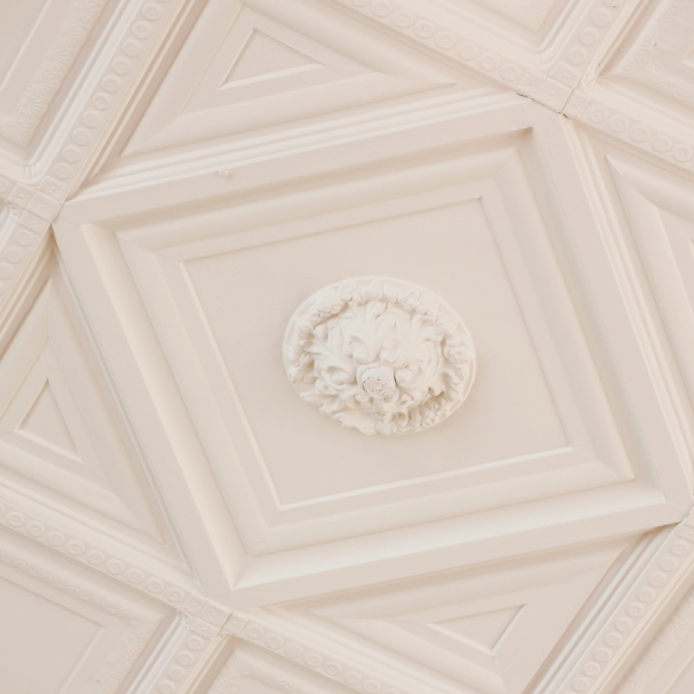 A painted tin ceiling adorns the former reading room