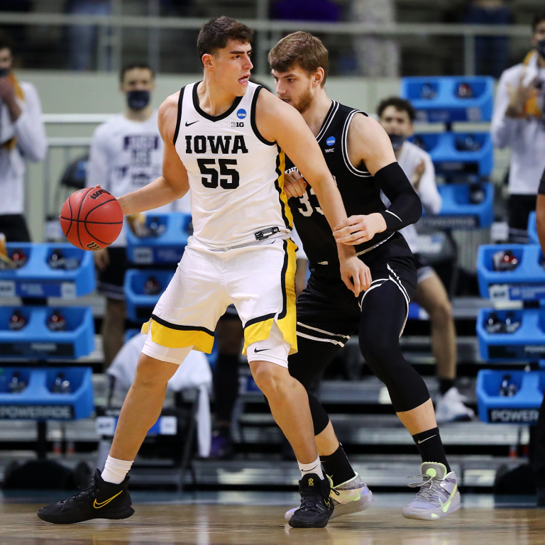 an Iowa players posts up against a Grand Canyon player