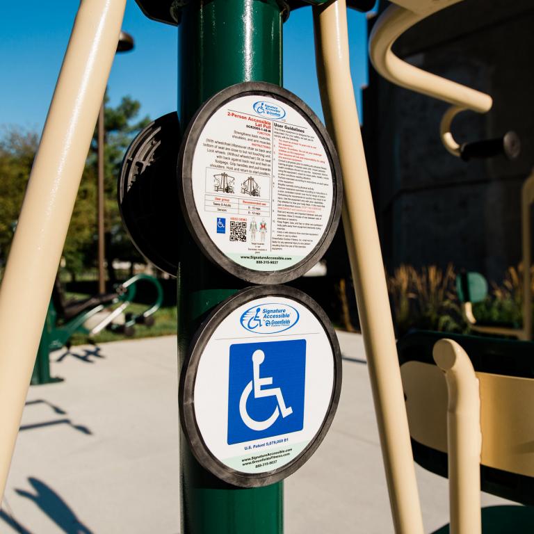 a closeup view of an instructional handicap accessible sign