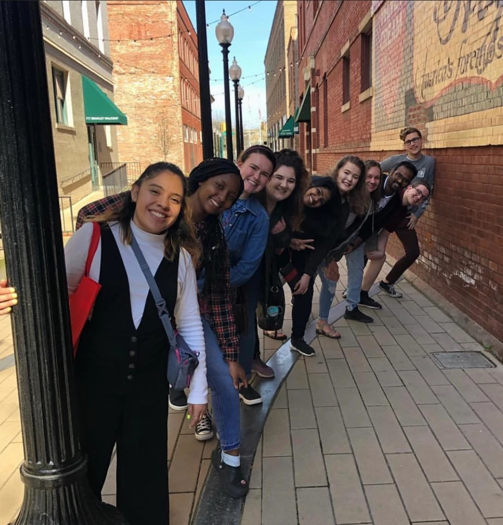 A group of friends pose in a West Virginia alleyway.