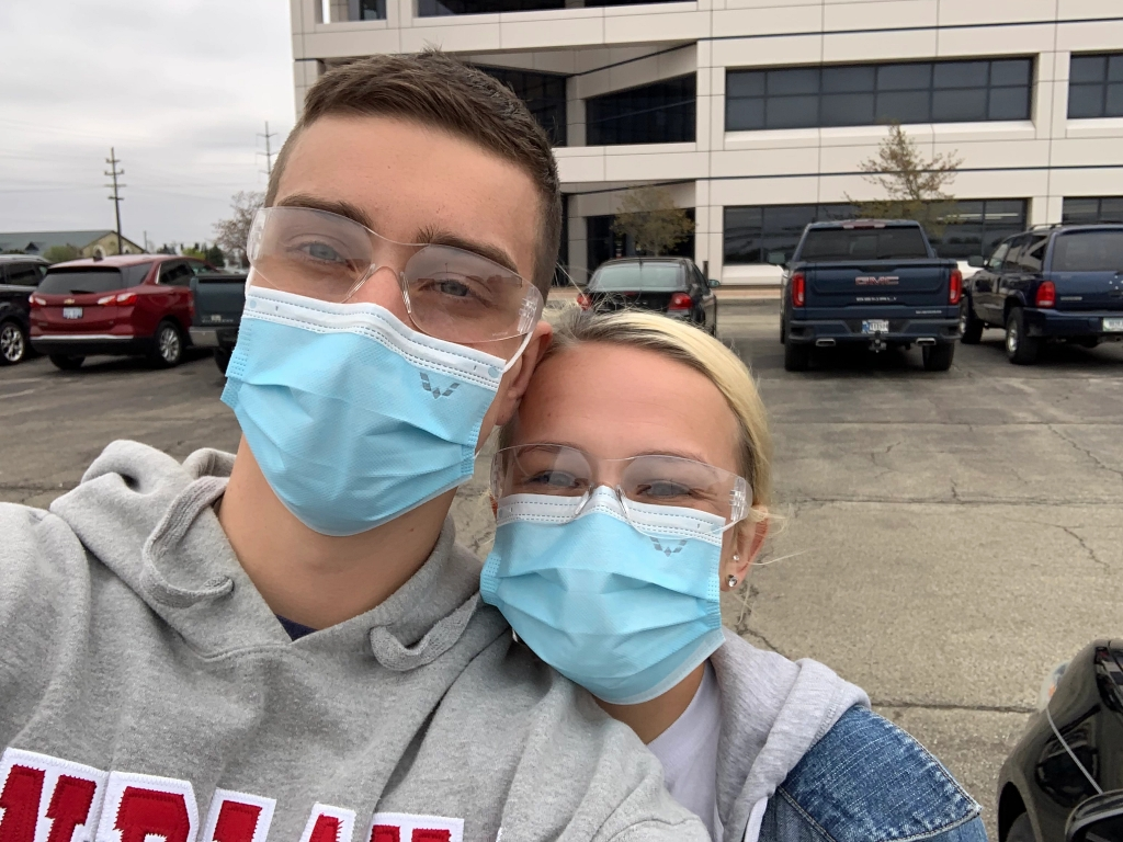Alex Combs and Kate Wampler wear face masks at GM
