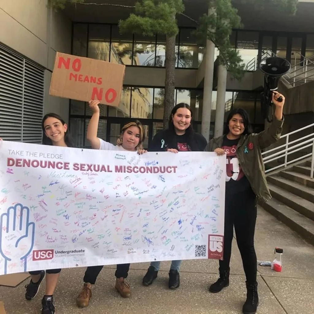 students holding banner and sign
