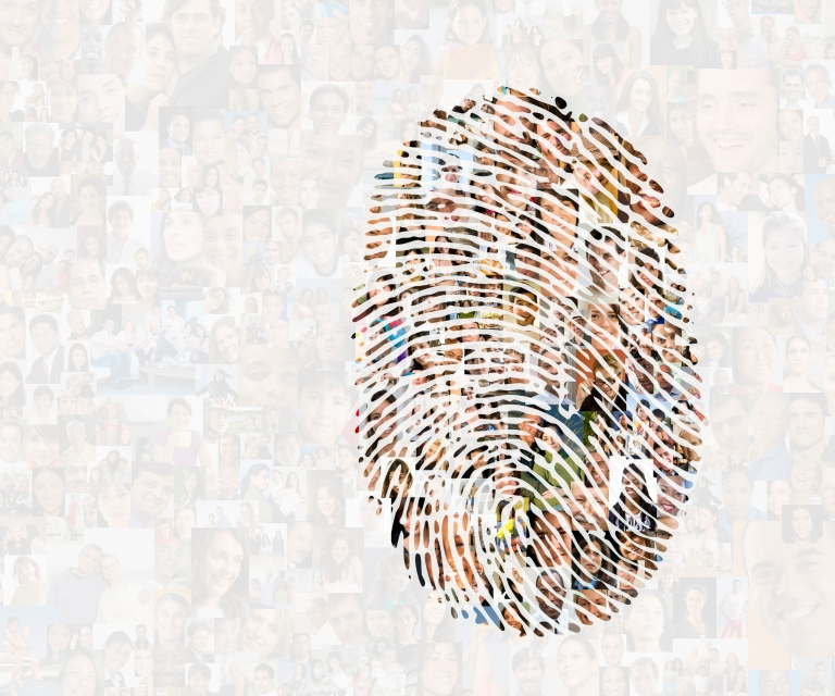A fingerprint made up of people's faces on a background