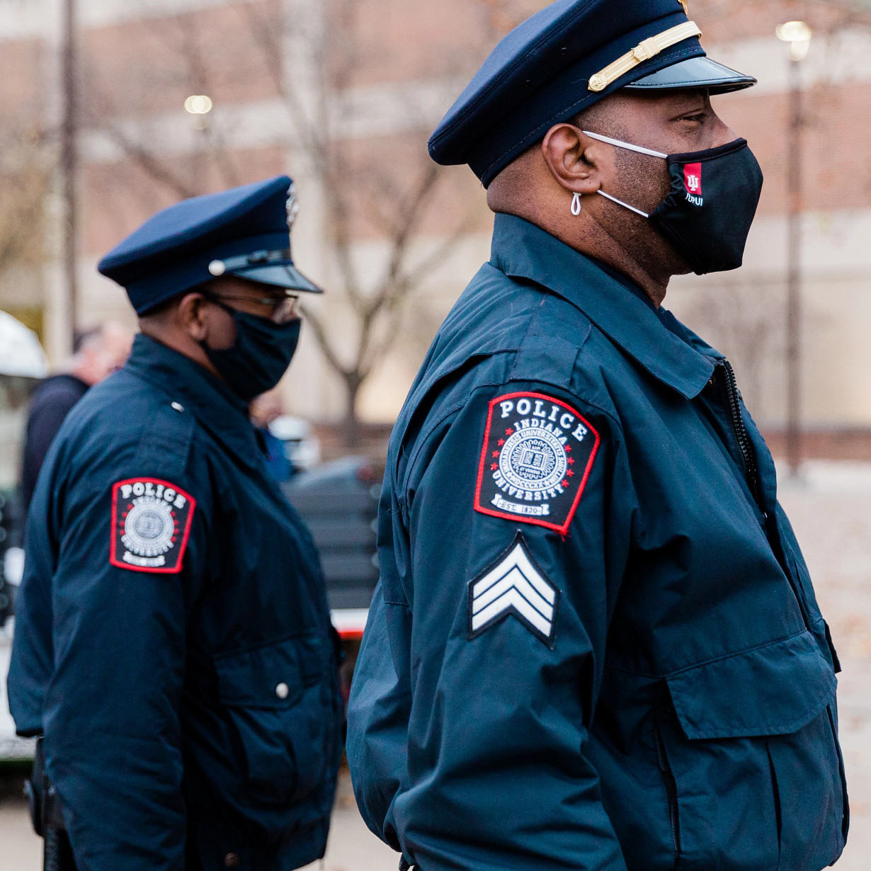 IUPUI PD officers stand outside while wearing masks