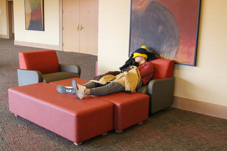 Student napping in the hallway in University Tower.