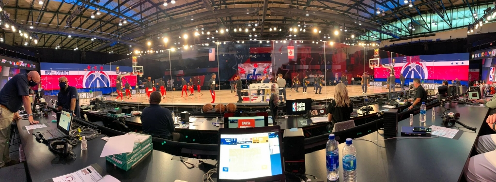 a panoramic view of the basketball court from the scorer's table