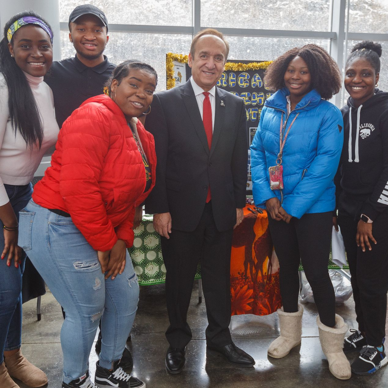 Chancellor Nasser Paydar poses with students