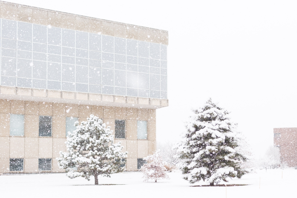 IUPUI Library covered in snow during a snow fall.