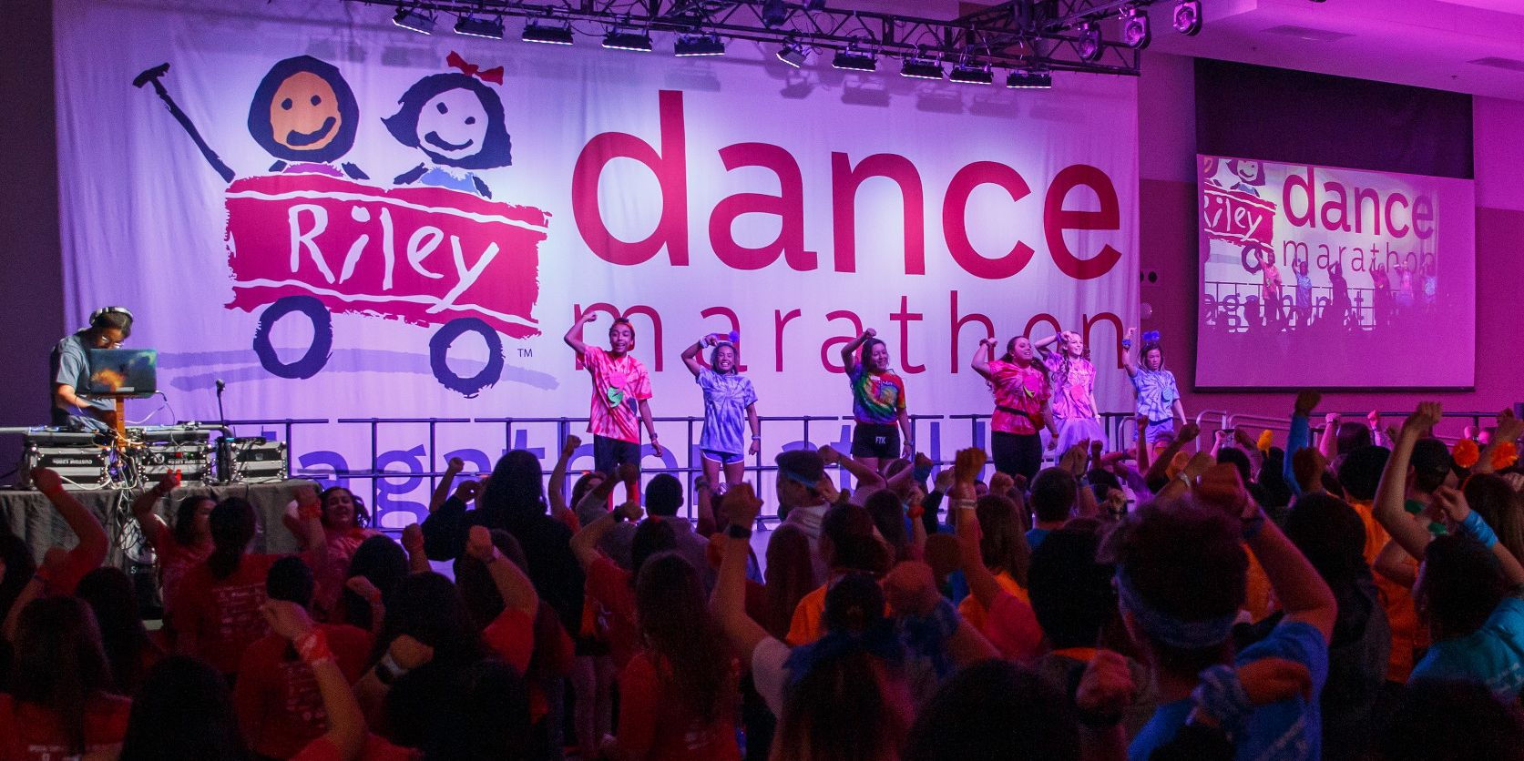 A large crowd packs the room at Jagathon, dancing along with the people onstage
