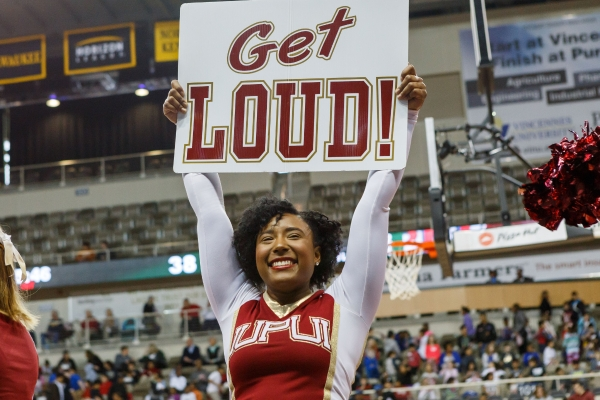 An IUPUI cheerleader informs the crowd it's time to get loud.