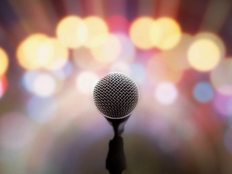 A microphone with a light-filled background