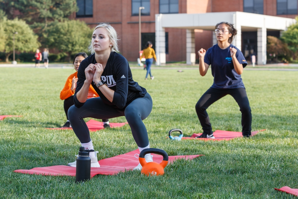 Students participate in fitness class at the Campus Recreation Outdoor Facility at IUPUI.