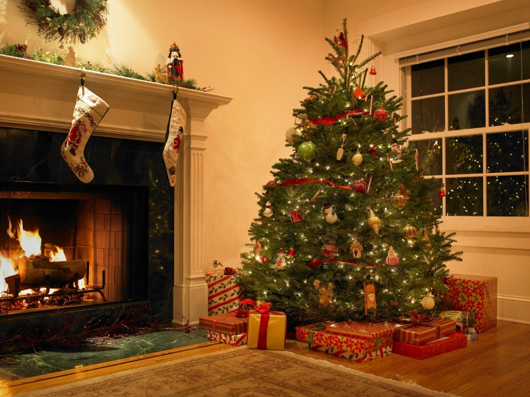 Wrapped gifts and a decorated Christmas tree near a fireplace