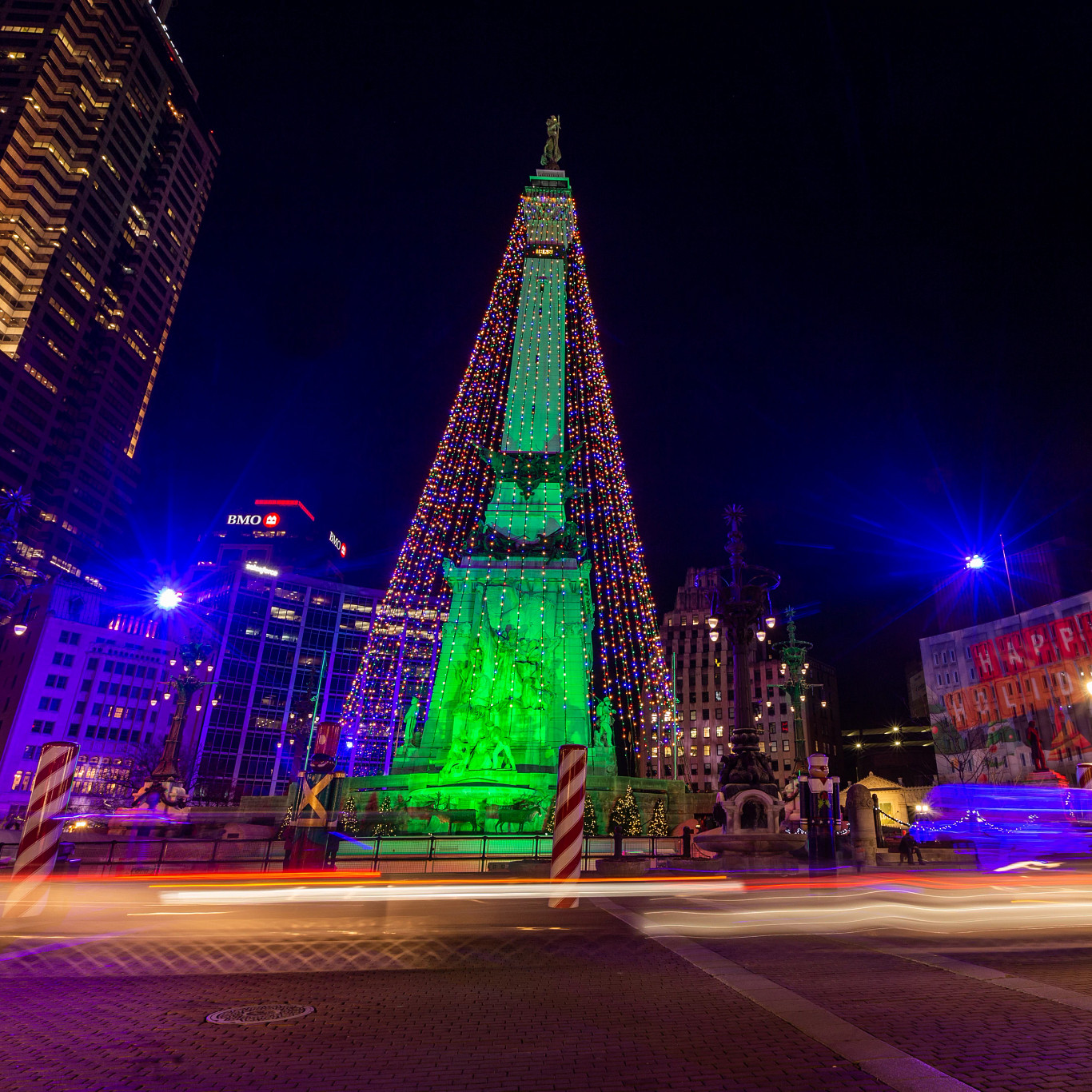 a long exposure captures movement on Monument Circle during Holidays