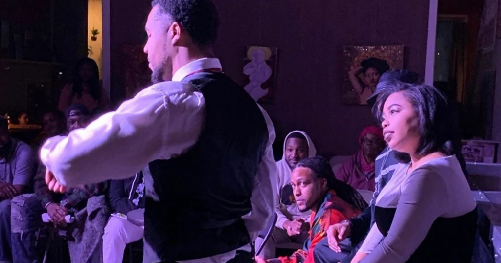Black actors perform on a stage while the audience watches in November 2019