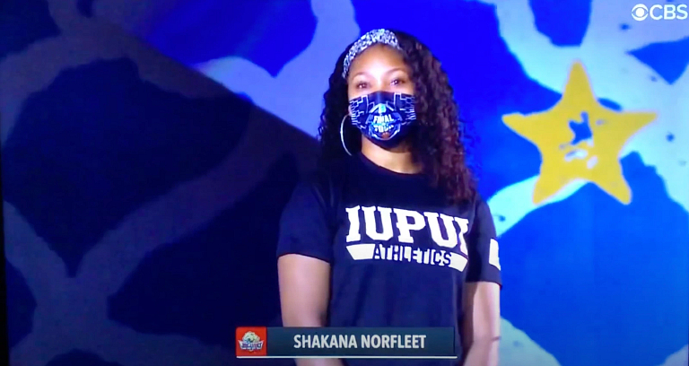 Shakana Norfleet is wearing a face mask and preparing to sing the national anthem live on CBS
