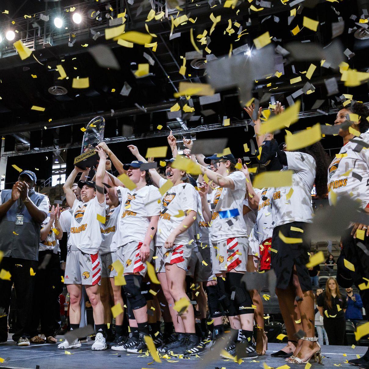 confetti falls from above as the IUPUI women's team celebrates