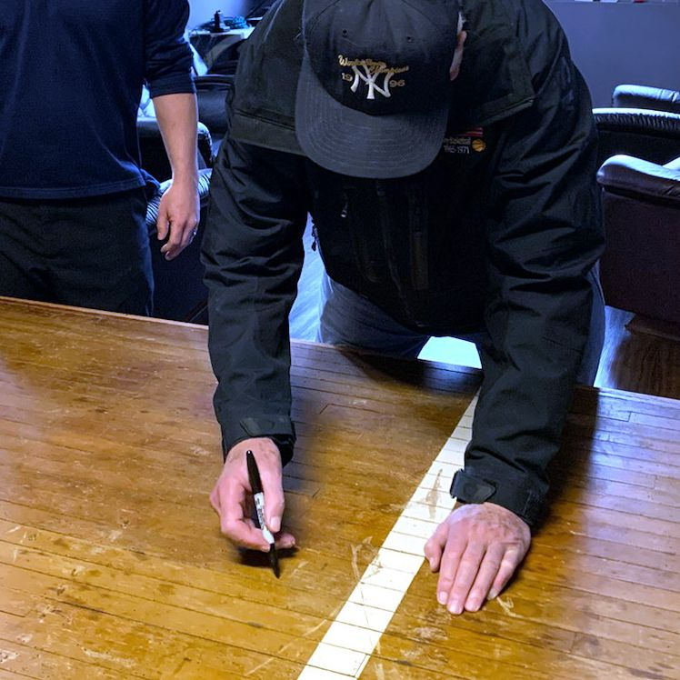 Bob Knight signing the table