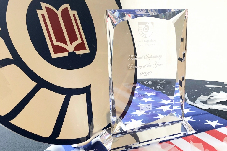 An award sits on top of an American flag
