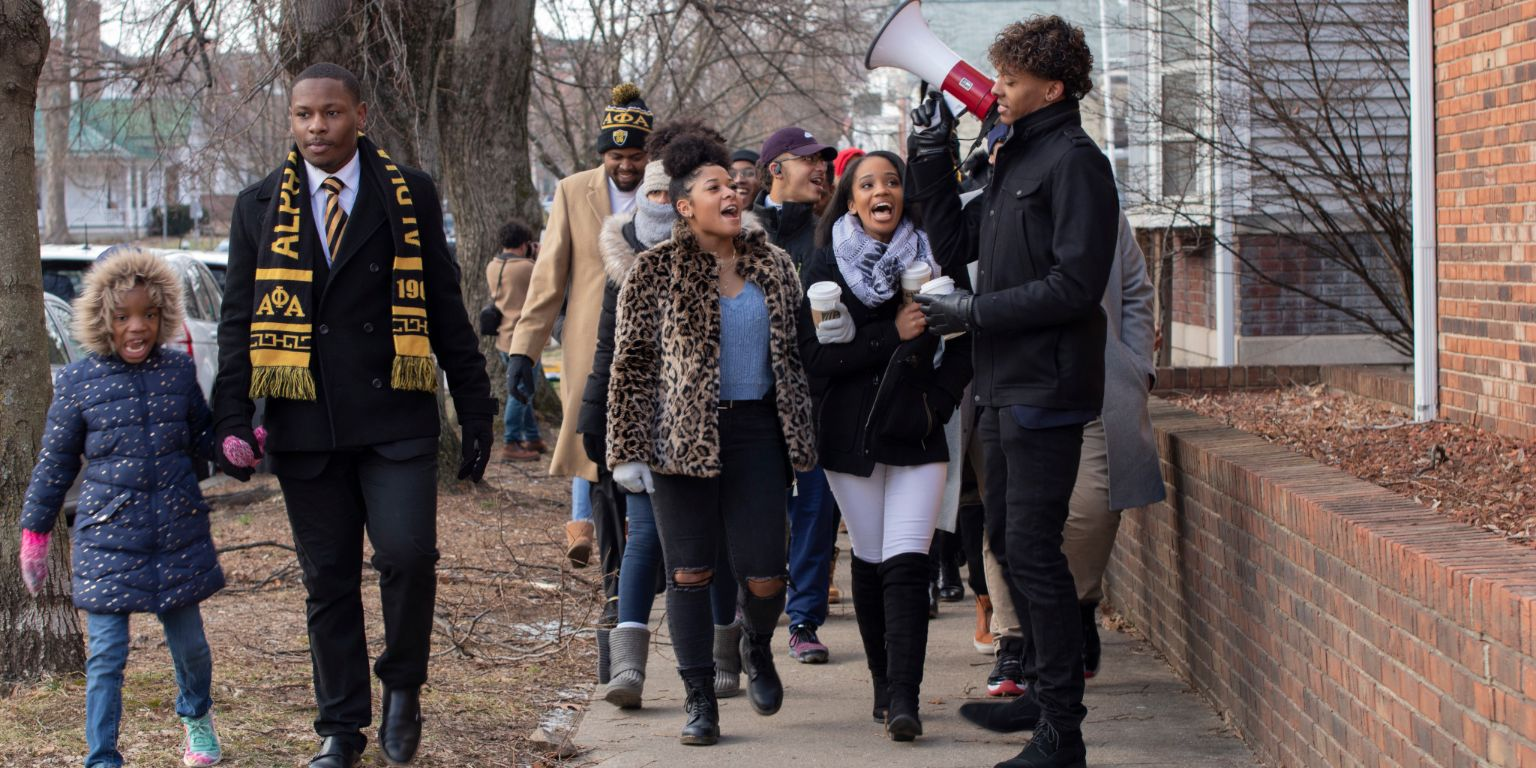 People participate in an MLK Day march in Bloomington on Jan. 20, 2020.