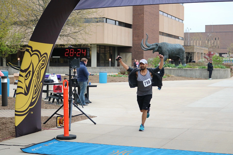 A runner crossing the finish line