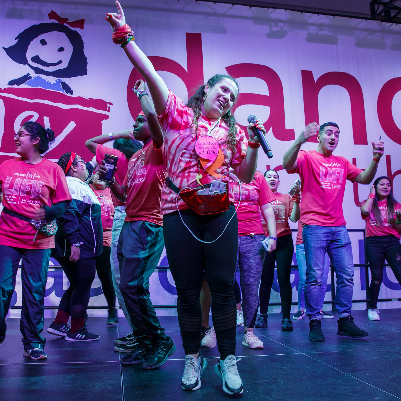 students stand onstage dancing for Jagathon