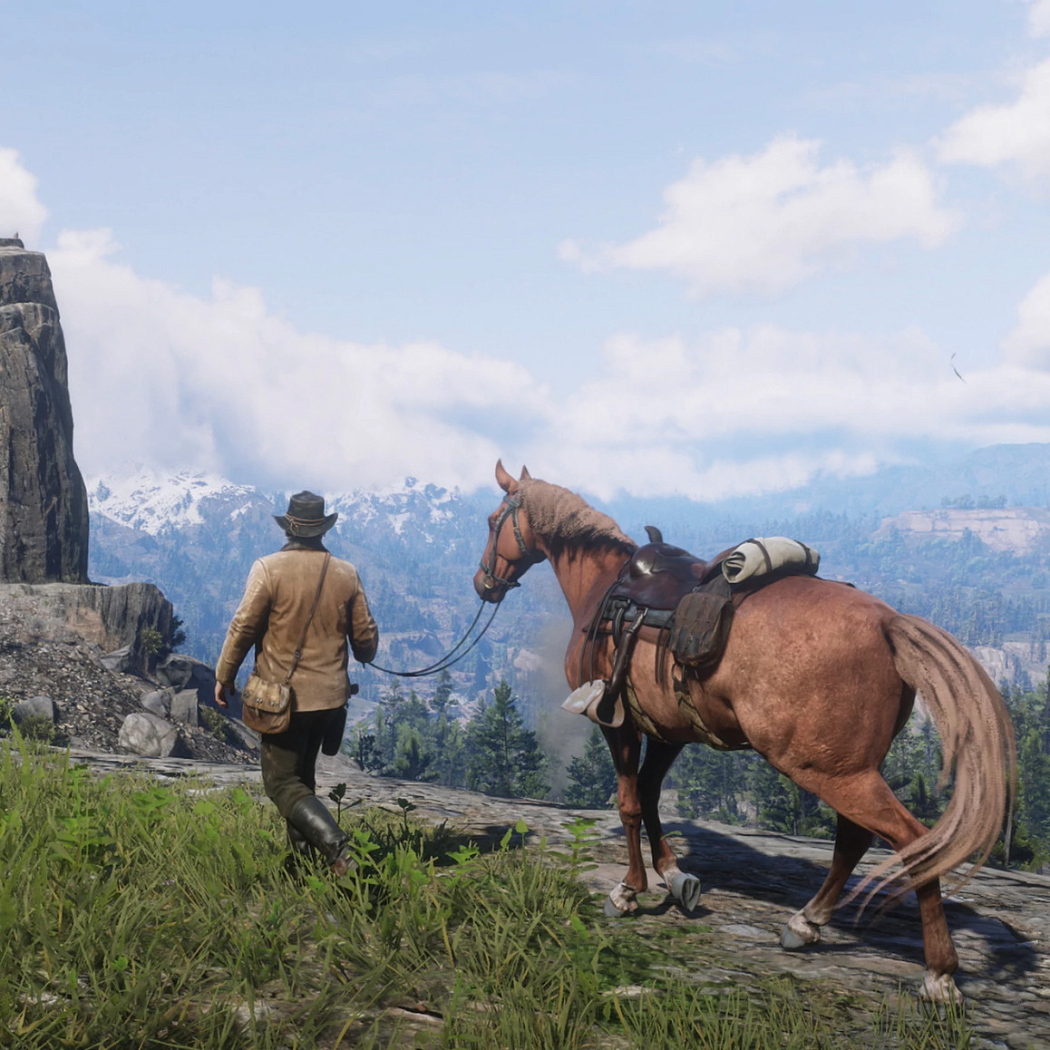 a man walking a horse in front of a mountainscape