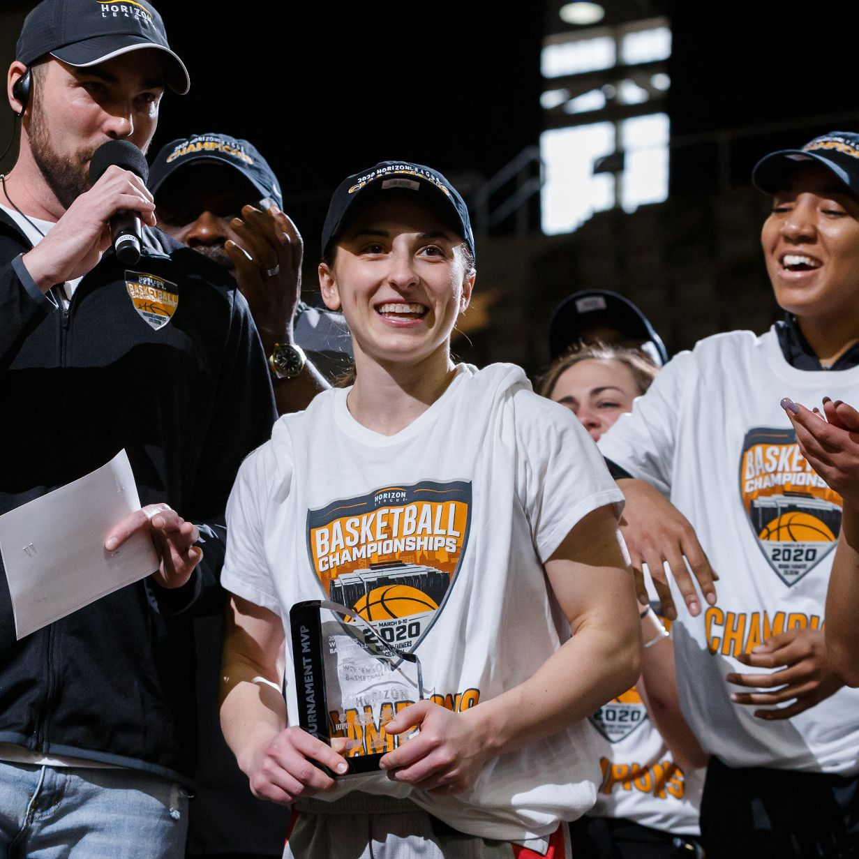 a woman accepts an MVP award on stage