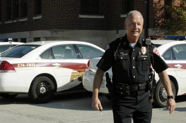 Bill Abston stands outside in his police uniform