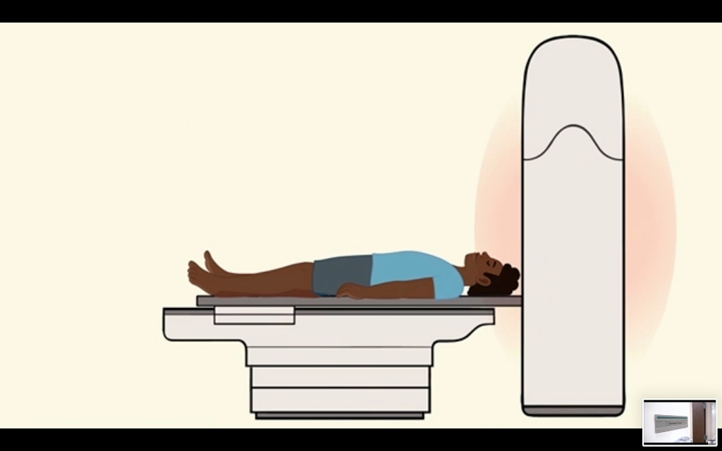A animation still depicting a patient entering an MRI machine