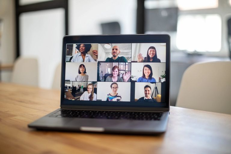 Group of people seen on a laptop screen having an online meeting