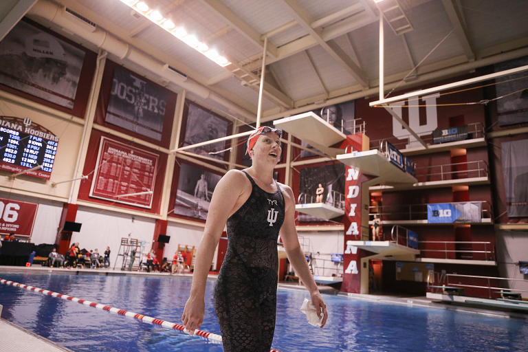 Lilly King walking outside the pool at IU