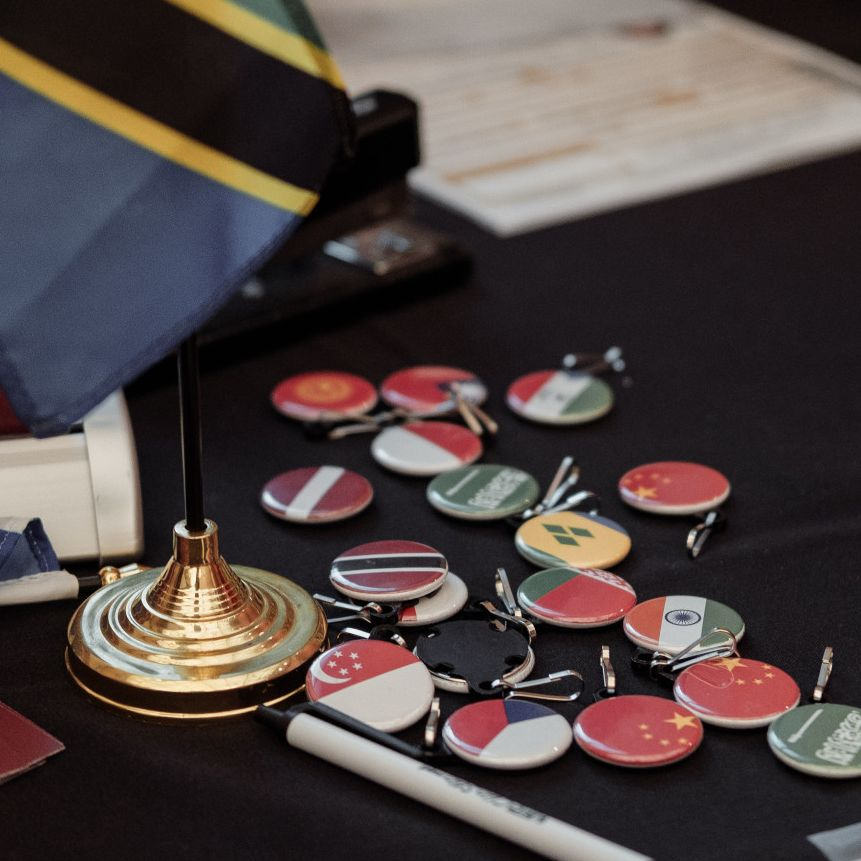Buttons and a flag representing foreign countries displayed at the Passport Caravan.