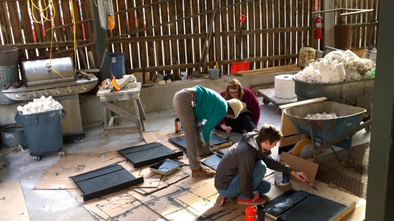 People building bat boxes