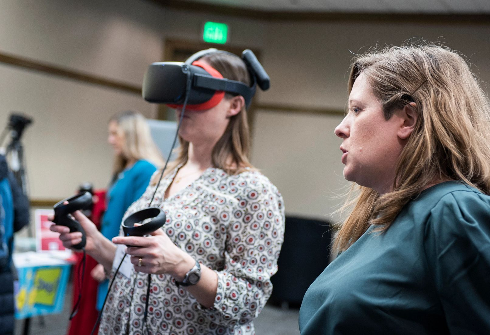 women's summit attendees using a virtual reality