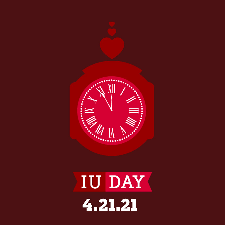 Graphic of a red clock with 'IU Day' and 'April 21, 2021'