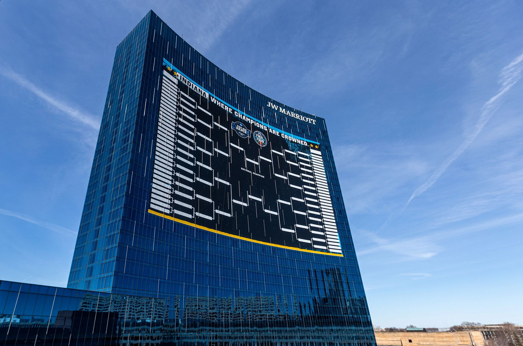 A tournament bracket covers most of the side of a downtown Indianapolis hotel
