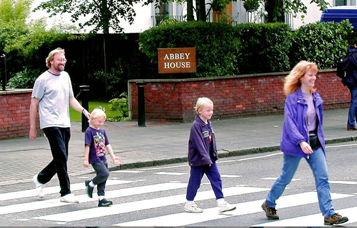 Glenn and his family walking across Abbey Road