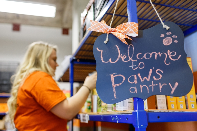 a sign that says Paws Pantry