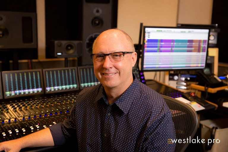 Richard Marvin sits in his recording studio