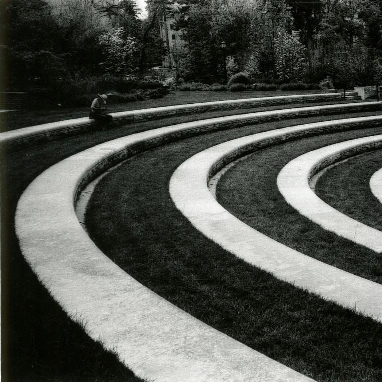 A person sits alone in otherwise empty Conrad-Prebys Amphitheater