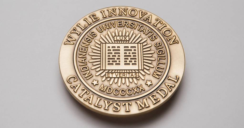 Gold circular medal that reads Wylie Innovation Catalyst Medal