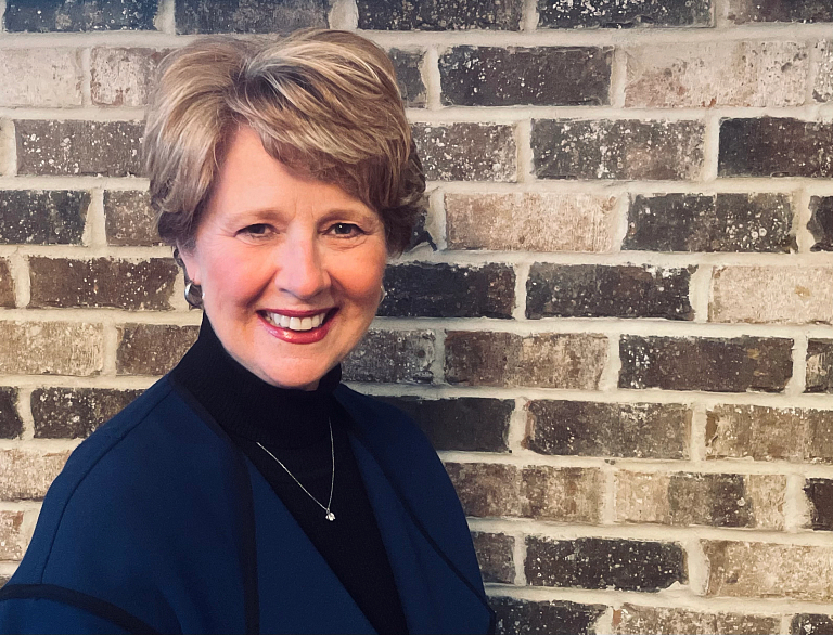 Susan Brooks in front of a brick wall