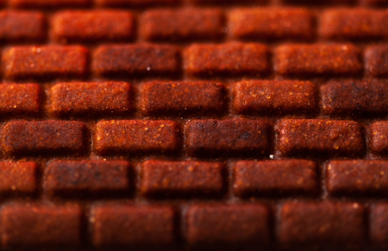 A close-up of brick details in gingerbread