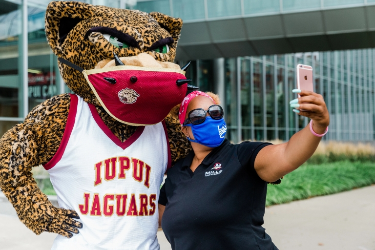 Jawz poses for a selfie with a fan with his custom-created face mask