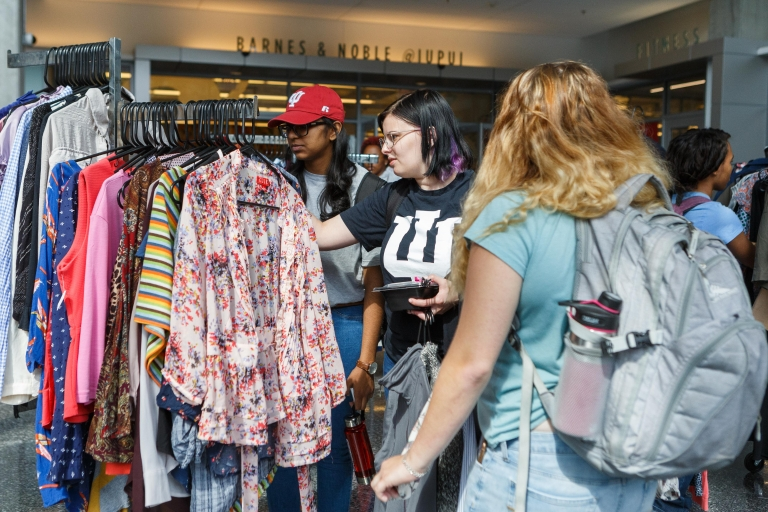 Students shop for professional and casual wear at the Paws' Closet Pop-up Shop.