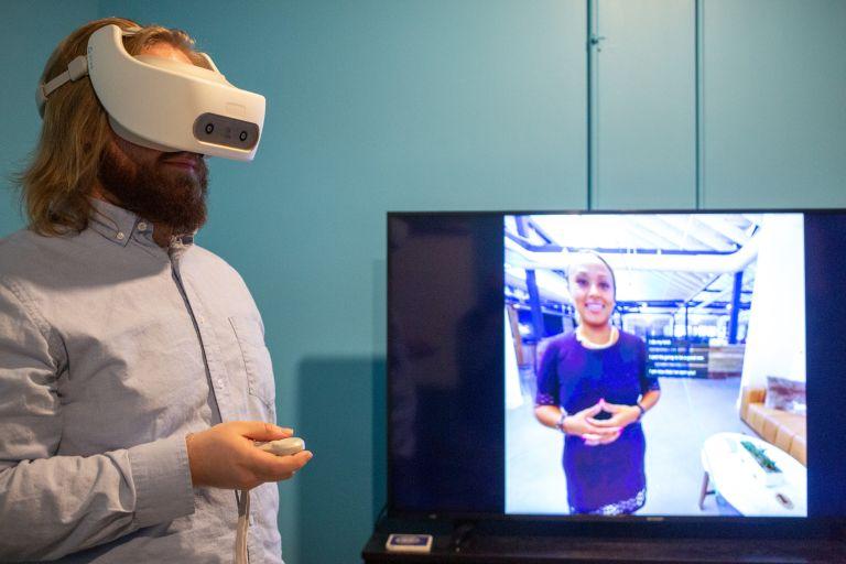Regatta VR employee Devin Good loads a virtual reality simulation.